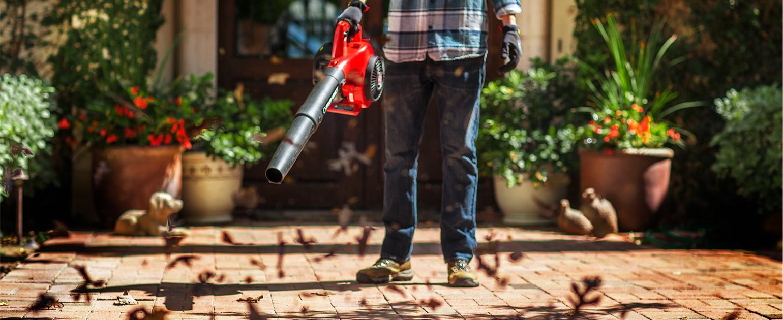 man using leaf blower towards ground