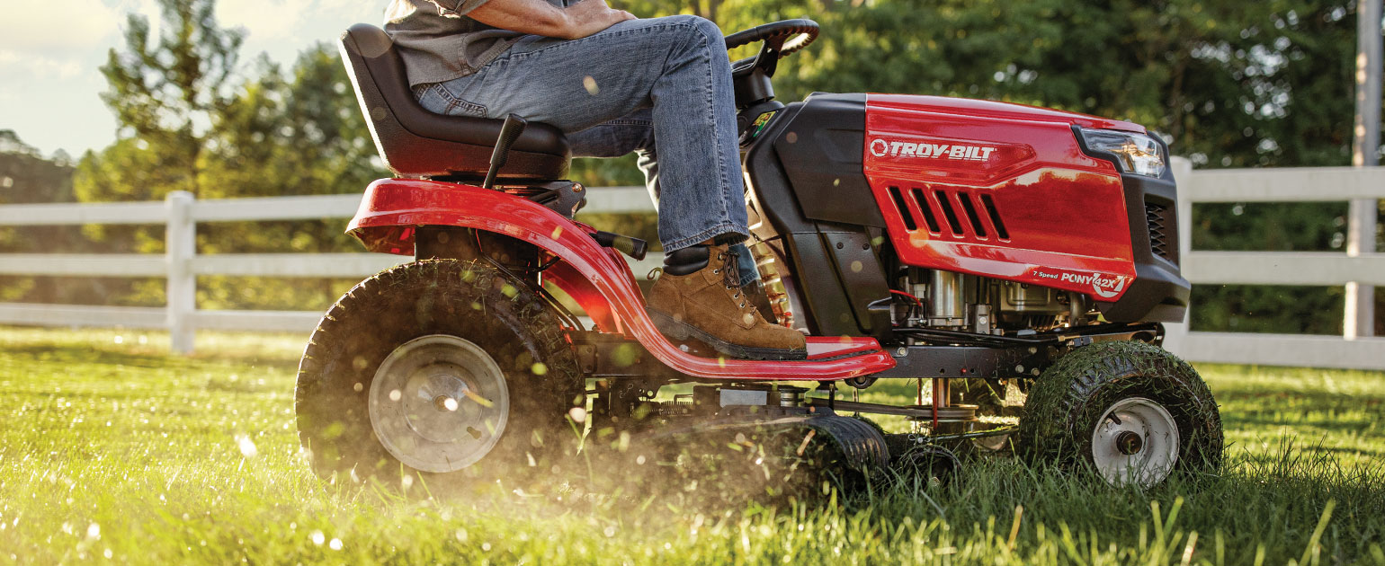 Man mowing lawn with Troy-Bilt Lawn Tractor