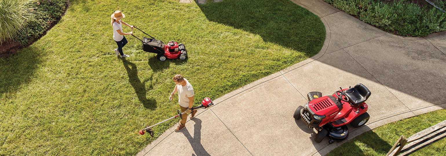 man and woman tending to lawn