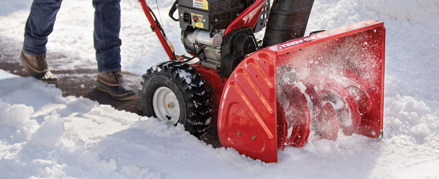 snow blower blowing snow