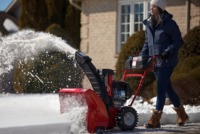 Woman clearing snow with troy-bilt snow blower