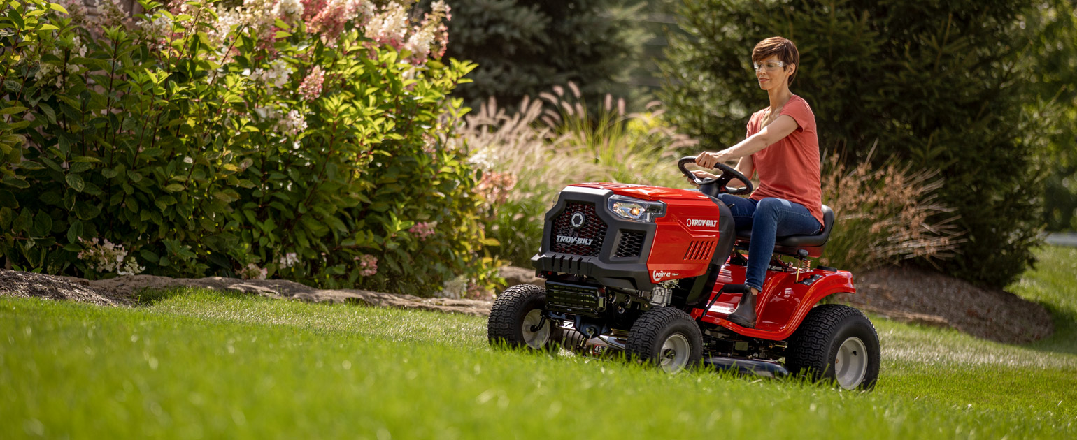 Woman mowing lawn with Troy-Bilt Lawn Tractor