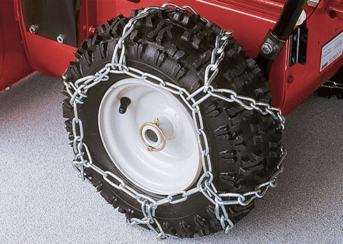 tire chains wrapped around snow blower tire