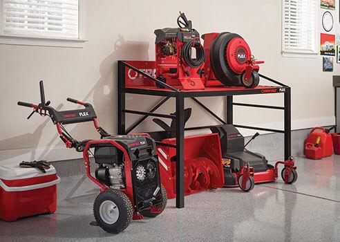 Troy-Bilt FLEX base and attachments in garage